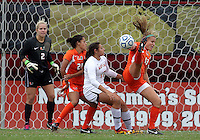 COLLEGE PARK, MD - OCTOBER 28, 2012:  Gabby Galanti (17) of the University of Maryland in action against Erin McGovern (13) of Miami during an ACC  women's tournament 1st. round match at Ludwig Field in College Park, MD. on October 28. Maryland won 2-1 on a golden goal in extra time.