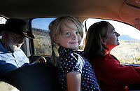 Riding in the front seat with her grandmother, Siobhan Lolly flashes a warm smile.  Sharon O'Toole drove her granddaughter and father George Salisbury around the Ladder Livestock Ranch in southern Wyoming (west of Bags at the Colorado border.) <br /> Peruvian shepherds work at the ranch watching over sheep.  Dot, an adopted mustang trained at the correctional center in Riverside, saved a shepherd's life by finding his way home on a cold night when they were lost.  Nelson, the saved worker, left years ago but the horse is still a favorite among ranch hands like Edgar. He is steady--rock solid--as they guard the sheep.