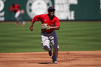 Boston Red Sox third baseman Rafael Devers (11) breaks towards the base for a throw down from the catcher during a Major League Spring Training game against the Atlanta Braves on March 7, 2021 at CoolToday Park in North Port, Florida.  (Mike Janes/Four Seam Images)