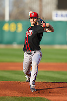 Lansing Lugnuts pitcher Taylor Cole #19 pitches during a game against the Cedar Rapids Kernels at Veterans Memorial Stadium on April 29, 2013 in Cedar Rapids, Iowa. (Brace Hemmelgarn/Four Seam Images)