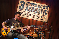 """Bassist Todd Harrell of 3 Doors Down performs on stage during the acoustic """"Songs From the Basement"""" tour at the House of Blues on Tuesday January 14, 2014 in Los Angeles, CA. (Photo by: Paul A. Hebert / Press Line Photos)"""