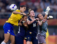 Australia goalkeeper (1) Melissa Barbieri tips the ball away from the heads of teammates Lauren Colthorpe (16) and Thea Slayter and Brazil defender (3) Aline during the quarterfinals of the FIFA Women's World Cup at Tianjin Olympic Center Stadium in Tianjin, China.  Brazil defeated Australia, 3-2.