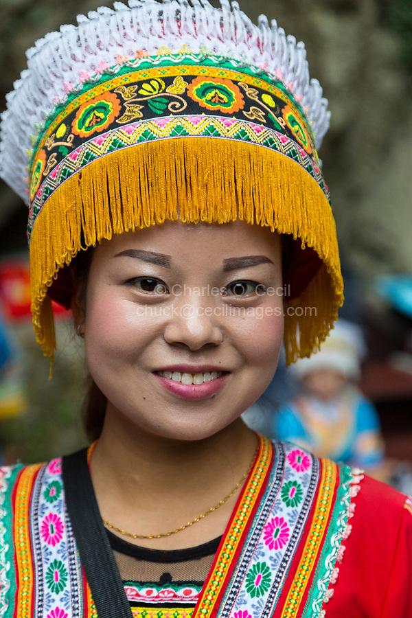 China, Guizhou, Dragon Palace Scenic Area.  Young Woman in Traditional Bouyei Dress.