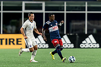 FOXBOROUGH, MA - SEPTEMBER 5: Michel #48 of New England Revolution II passes the ball as Kristofer Strickler #15 of Tormenta FC closes during a game between Tormenta FC and New England Revolution II at Gillette Stadium on September 5, 2021 in Foxborough, Massachusetts.