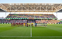 AUSTIN, TX - JUNE 16: The USWNT and Nigeria stand during introductions before a game between Nigeria and USWNT at Q2 Stadium on June 16, 2021 in Austin, Texas.