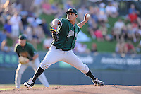 Starting pitcher Luis Ysla (49) of the Augusta GreenJackets delivers a pitch in a game against the Greenville Drive on Thursday, July 10, 2014, at Fluor Field at the West End in Greenville, South Carolina. Augusta won, 8-2. (Tom Priddy/Four Seam Images)