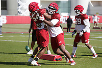 Andy Boykin (44) participates in an tackling drill with during the University of Arkansas Razorback Spring football practice Thursday, April 1, 2021, at the University practice field on the campus in Fayetteville. Check out nwaonline.com/210402Daily/ and nwadg.com/photos for a photo gallery.<br /> (NWA Democrat-Gazette/David Gottschalk)