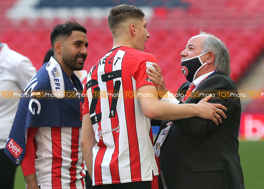 Brentford Chairman, Cliff Crown congratulates Vitaly Janet at the final whistle as Saman Ghoddos looks on during Brentford vs Swansea City, Sky Bet EFL Championship Play-Off Final Football at Wembley Stadium on 29th May 2021