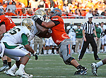Oklahoma State Cowboys offensive linesman Lane Taylor (68) and Baylor Bears defensive tackle Tracy Robertson (13) in action during the game between the Baylor Bears and the Oklahoma State Cowboys at the Boone Pickens Stadium in Stillwater, OK. Oklahoma State defeats Baylor 59 to 24.