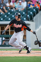 Sean Halton (21) of the Norfolk Tides follows through on his swing against the Charlotte Knights at BB&T BallPark on July 17, 2015 in Charlotte, North Carolina.  The Knights defeated the Tides 5-4.  (Brian Westerholt/Four Seam Images)