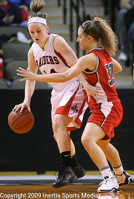 SIOUX CITY, IA - MARCH 14, 2009 --  Becca Hurley #14 of Northwestern College drives around Kallie Benike #32 of Davenport University during their 2009 NAIA DII Women's Basketball National Championship quarterfinal game Saturday at the Tyson Events Center in Sioux City. (Photo by Dick Carlson/Inertia)