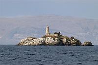 - little island with lighthouse to the wide of the Corfù island....- isolotto con faro al largo dell'isola di Corfù..