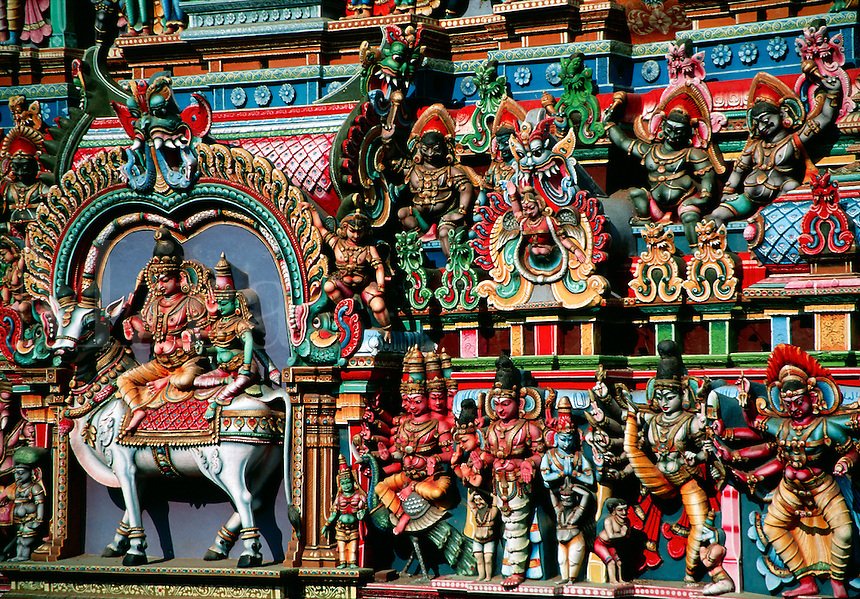 Detail of colorfully decorated gopuram Religious Tower Shree Meenakshi Hindu Temple Madurai India