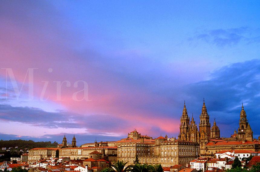 Spain, Galicia, Santiago de Compostela. Cathedral of the Apostle and the casco antiguo (old town), view from the park Carballeiria de Santa Susana. Rainbow.