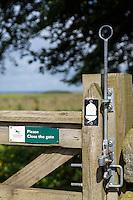 Northumberland,  England, UK.  Gate Latch on Hadrian's Wall Footpath, with Acorn Emblem.