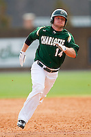 Tony Montalbano #14 of the Charlotte 49ers hustles towards third base with a triple against the Saint Peter's Peacocks at Robert and Mariam Hayes Stadium on February 18, 2012 in Charlotte, North Carolina.  Brian Westerholt / Four Seam Images