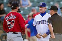 Round Rock Express manager Steve Buchele #22 talks with Memphis Redbirds manager Pop Warner #57 before the Pacific Coast League baseball game against the Memphis Redbirds on April 24, 2014 at the Dell Diamond in Round Rock, Texas. The Express defeated the Redbirds 6-2. (Andrew Woolley/Four Seam Images)