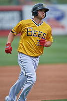 Scott Schebler (33) of the Salt Lake Bees circles the bases during the game against the Tacoma Rainiers at Smith's Ballpark on May 16, 2021 in Salt Lake City, Utah. The Bees defeated the Rainiers 8-7. (Stephen Smith/Four Seam Images)