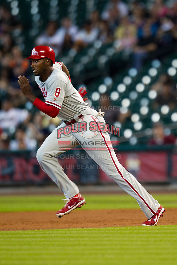 Philadelphia Phillies outfielder Domonic Brown #9 runs to second base during the Major League baseball game against the Houston Astros on September 16th, 2012 at Minute Maid Park in Houston, Texas. The Astros defeated the Phillies 7-6. (Andrew Woolley/Four Seam Images).