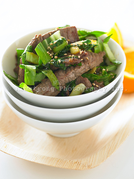 Strips of stir-fried beef and greens, topped with sesame seeds.