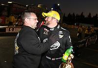 Feb. 17, 2013; Pomona, CA, USA; NHRA top fuel dragster driver Shawn Langdon celebrates with crew after winning the Winternationals at Auto Club Raceway at Pomona. Mandatory Credit: Mark J. Rebilas-