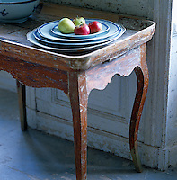 Detail of a distressed wooden tray table used for serving tea