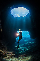 free diver, Sandy Hammel, exploreing an underwater lava tube known as Skull Cave, Suck 'em Up dive site, Kohanaiki, Kona Coast, Big Island, Hawaii, USA, Pacific Ocean MR 489