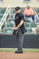 Home plate umpire Colin Baron works the South Atlantic League game between the Rome Braves and the Kannapolis Intimidators at Kannapolis Intimidators Stadium on April 7, 2019 in Kannapolis, North Carolina. The Intimidators defeated the Braves 2-1. (Brian Westerholt/Four Seam Images)
