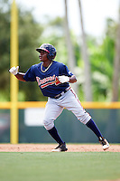 GCL Braves shortstop Nicholas Shumpert (92) leads off first during a game against the GCL Pirates on August 10, 2016 at Pirate City in Bradenton, Florida.  GCL Braves defeated the GCL Pirates 5-1.  (Mike Janes/Four Seam Images)