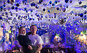 """30/11/15<br /> <br /> Ava Hodgson, and her dad Daniel, marvel at the amazing decorations in the 'Indoor Igloo'.<br /> <br /> It has taken a team of five, two weeks to put up this stunning display of Christmas decorations in what is believed to be one of Britain's most festive pubs. The race was on to put up the 7,500 baubles and 27,000 fairy lights, before guests arrived for the pub's first Christmas parties held last night. <br /> <br /> Each of the five rooms at the Hanging Gate at Chapel-en-le-Frith in the Derbyshire Peak District has a different theme or colour. This year the main restaurant is the Indoor Igloo, the bar area is purple and gold and there's the Candy Cain room upstairs in the pub near Buxton. There's also has another 10,000 lights on the outside of the building. <br /> <br /> """"We've had to replace a few thousand of the LED lights this year, I buy them in huge lengths so it's cost lots  to get everything ready"""" said landlord Mark Thomas.<br /> <br /> All Rights Reserved: F Stop Press Ltd. +44(0)1335 418365   www.fstoppress.com."""