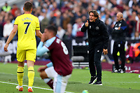 3rd October 2021;   City of London Stadium, London, England; EPL Premier League football, West Ham versus Brentford; Brentford Manager Thomas Frank gestures to Sergi Canos
