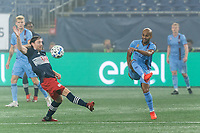 FOXBOROUGH, MA - SEPTEMBER 02: Heber #9 of New York City FC passes the ball as Tommy McNamara #26 of New England Revolution defends during a game between New York City FC and New England Revolution at Gillette Stadium on September 02, 2020 in Foxborough, Massachusetts.