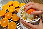Making fresh orange juice, press out oranges, squeeze oranges