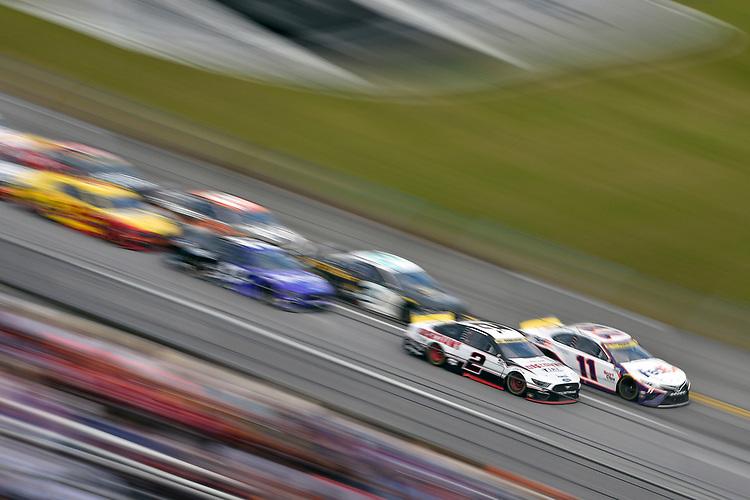 #2: Brad Keselowski, Team Penske, Ford Mustang Discount Tire and #11: Denny Hamlin, Joe Gibbs Racing, Toyota Camry FedEx Express