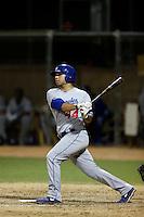 Julian Leon #44 of the AZL Dodgers bats against the AZL Athletics at Phoenix Municipal Stadium on July 10, 2013 in Phoenix, Arizona. AZL Athletics defeated the AZL Dodgers, 7-1. (Larry Goren/Four Seam Images)