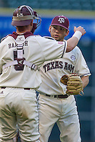 Texas A&M Aggies pitcher Mark Ecker (28) is congratulated by catcher Michael Barash (5) after saving a game in the Houston College Classic against the Nebraska Cornhuskers on March 6, 2015 at Minute Maid Park in Houston, Texas. Texas A&M defeated Nebraska 2-1. (Andrew Woolley/Four Seam Images)