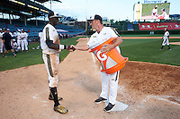 Taylor Trammell (5) of Mt. Paran Christian High School in Powder Springs, Georgia is presented a Gatorade cooler by Andy Ferguson after the Under Armour All-American Game on August 15, 2015 at Wrigley Field in Chicago, Illinois. (Mike Janes/Four Seam Images)
