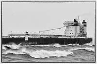 American Integrity Stormy Departure<br /> The thousand footer, American Integrity, departed Duluth during the first winter storm of the season. This laker typically transports coal or iron ore on the Great Lakes, with a capacity of 78,850 tons.