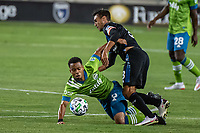 SAN JOSE, CA - OCTOBER 18: Jordy Delem #8 of the Seattle Sounders and Chris Wondolowski #8 of the San Jose Earthquakes battle for the ball during a game between Seattle Sounders FC and San Jose Earthquakes at Earthquakes Stadium on October 18, 2020 in San Jose, California.