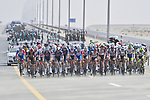 Crosswinds start to blow across the peloton during Stage 1 of the 2021 UAE Tour the ADNOC Stage running 176km from Al Dhafra Castle to Al Mirfa, Abu Dhabi, UAE. 21st February 2021.  <br /> Picture: LaPresse/Fabio Ferrari | Cyclefile<br /> <br /> All photos usage must carry mandatory copyright credit (© Cyclefile | LaPresse/Fabio Ferrari)