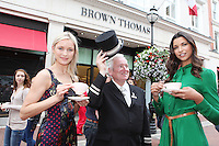NO REPRO FEE. 4/8/2011. A Taste of Carton House in Brown Thomas Dublin.Browns Bar and Café by Carton House opens in Ireland's Premier Department Store. Models Teo Sutra and Angelica Salomao with door man Ciaran were pictured today ( August 4th 2011) indulging in Afternoon Tea with a stylish twist outside Brown Thomas Dublin on Grafton Street as Carton House, one of Ireland's most luxurious hotels, officially opened the doors of the most fashionable café in the heart of Dublin - Browns Bar & Café by Carton House which is housed within the iconic department store. Picture James Horan/Collins Photos