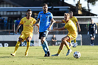 18th April 2021; Leichardt Oval, Sydney, New South Wales, Australia; A League Football, Sydney Football Club versus Adelaide United; Anthony Caceres of Sydney passes the ball under pressure from Stefan Mauk of Adelaide United