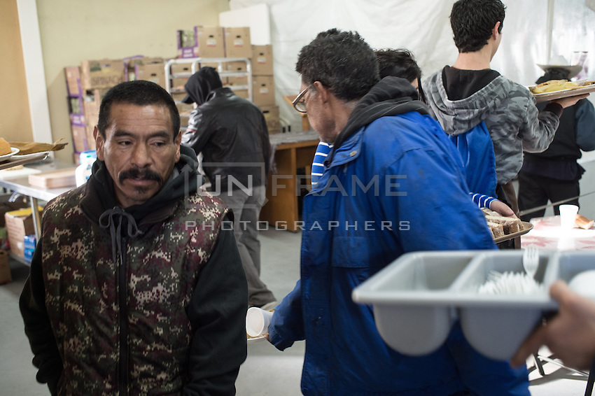 Queuing for a daily meal at Casa del Padre Chave, a church for homeless who have been deported from US. Tijuana, Mexico. Jan 05, 2015.