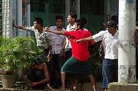 Pro-democracy demonstrators use catapults and hurl stones at an army line further down the road. Protests calling for the overthrow of the country's military junta had continued despite a violent response from the authorities.