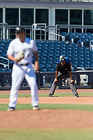 Field umpire Jeremie Rehak watches pitcher Daniel Brown (49) during an Arizona Fall League game between the Scottsdale Scorpions and the Peoria Javelinas at Peoria Sports Complex on October 18, 2018 in Peoria, Arizona. Scottsdale defeated Peoria 8-0. (Zachary Lucy/Four Seam Images)