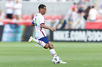 SANDY, UT - JUNE 10: Tyler Adams #4 of the United States passes the ball during a game between Costa Rica and USMNT at Rio Tinto Stadium on June 10, 2021 in Sandy, Utah.