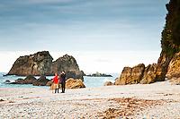Women and boy on remote, wild West Coast beach - South Westland, West Coast, New Zealand