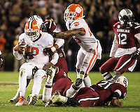 The tenth ranked South Carolina Gamecocks host the 6th ranked Clemson Tigers at Williams-Brice Stadium in Columbia, South Carolina.  USC won 31-17 for their fifth straight win over Clemson.  South Carolina Gamecocks defensive tackle Kelcy Quarles (99), South Carolina Gamecocks linebacker T.J. Holloman (11), Clemson Tigers quarterback Tajh Boyd (10)