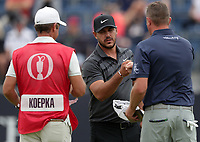 15th July 2021; Royal St Georges Golf Club, Sandwich, Kent, England; The Open Championship, PGA Tour, European Tour Golf,  First Round ; Brooks Koepka (USA) bumps fists with playing partner Jason Kokrak (USA) on the 18th green