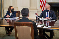US President Joe Biden, with Vice President Kamala Harris, delivers remarks during a meeting with Secretary of Health and Human Services Xavier Becerra, Secretary of Homeland Security Alejandro Mayorkas and  immigration advisors in the State Dining Room of the White House in Washington, DC, USA, 24 March 2021. President Biden is facing a renewed influx of migrants at the US-Mexico border following his policy changes since taking office in January.<br /> CAP/MPI/RS<br /> ©RS/MPI/Capital Pictures